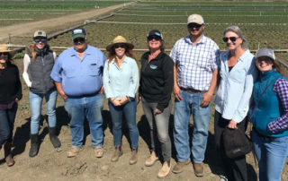 Photo of OFRF staff with staff members at Lakeside Organic Gardens