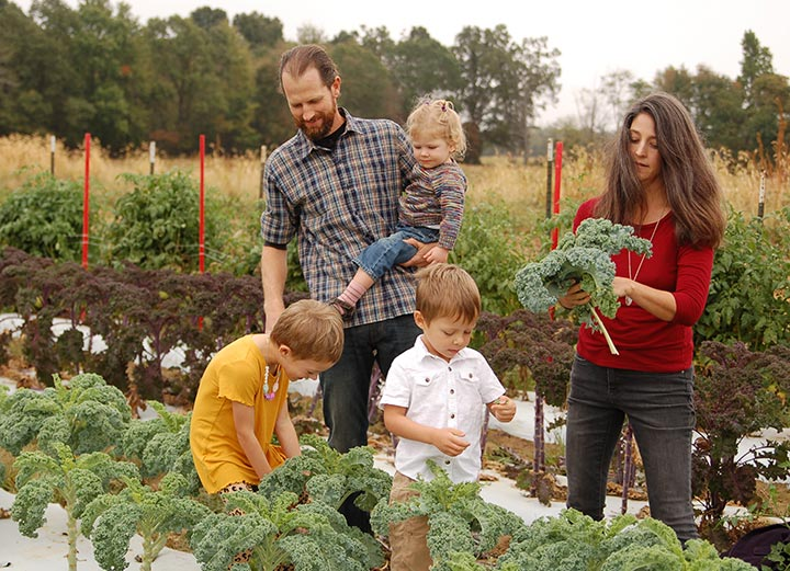 Photo of Barr Family picking veggies on the farm at Barr Farms